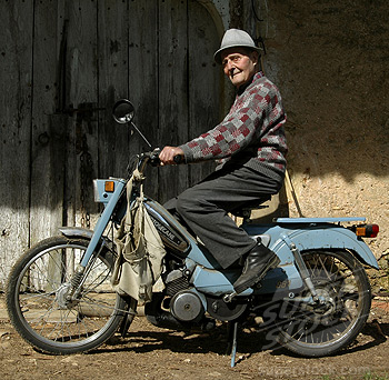 France, Aquitaine, Dordogne, Besse, old man on a old motorcycle