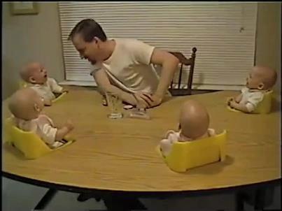 Newborn quadruplets think their dad is hilarious