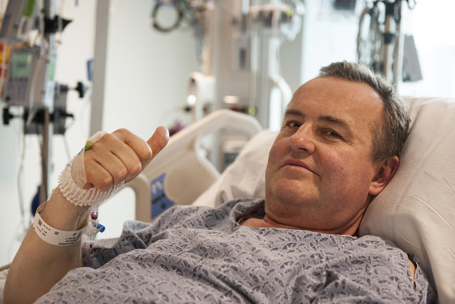 In this May 13, 2016 photo provided by Massachusetts General Hospital, Thomas Manning gives a thumbs up after being asked how he was feeling following the first penis transplant in the United States, in Boston. The organ was transplanted from a deceased donor. (Sam Riley/Mass General Hospital via AP) MANDATORY CREDIT